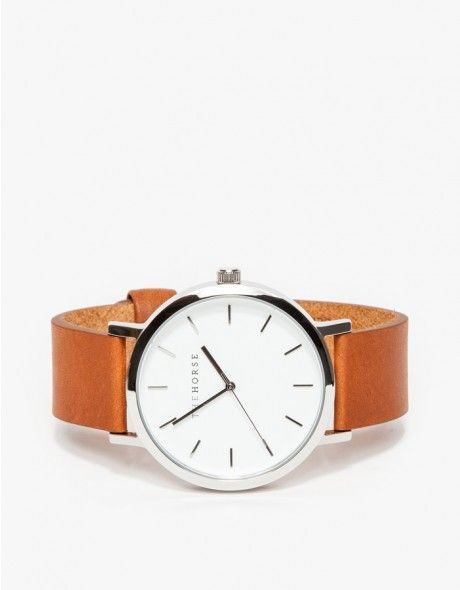 A simple and clean, oversized wrist watch from The Horse with a large polished stainless steel case, white face and premium tan leather band.   •Minimal, oversized wristwatch  •Genune Italian leather details and lining •Japanese Quartz movement