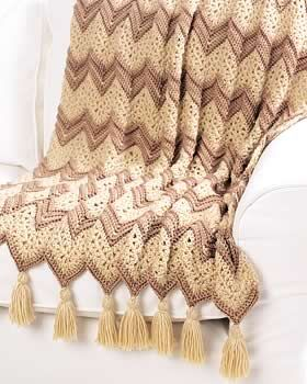 This #crochet ripple afghan pattern calls for elegant beige colors and fancy tassels.  This ripple afghan is worked in single crochet for a sturdy and warm cover.