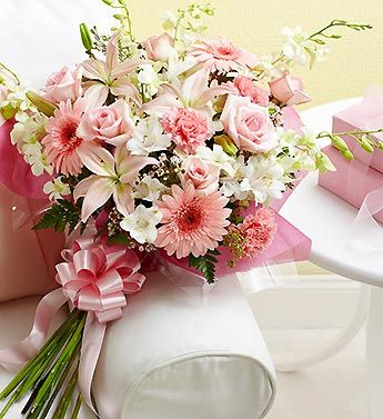 Kudos Bouquet™- alstroemeria, carnations, Gerberas, roses, waxflower, lilies, orchids, leather leaf and seeded eucalyptus $49.99-$99.99