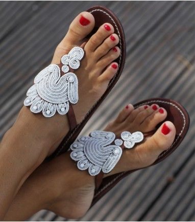 These vibrant Leather Beaded Sandal showcases African Tribal Beading at it's most beautiful. Our shops most popular sandal this season and a 2013 must have! Handmade in Kenya. Thong style sandal. Genuine leather upper (dyed & sun dried) with contrasting white stitching. Flat flexible rubber sole (0.4'').