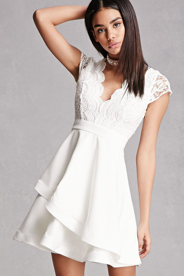 A woven dress featuring a crochet bodice with a sheer back and cap sleeves, a scalloped deep V-neckline, an asymmetrical tired full skirt, and an exposed back zipper. This is an independent brand and not a Forever 21 branded item.