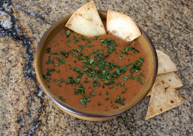 This is an easy bean dip made refried beans, cheese, salsa, and a little heat from pepper sauce. Serve this bean dip with corn tortilla chips.