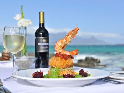 """""""On The Rocks"""" restaurant in Bloubergstrand is a stunning romantic location. Dine on the beach and enjoy postcards views of Table Mountain"""