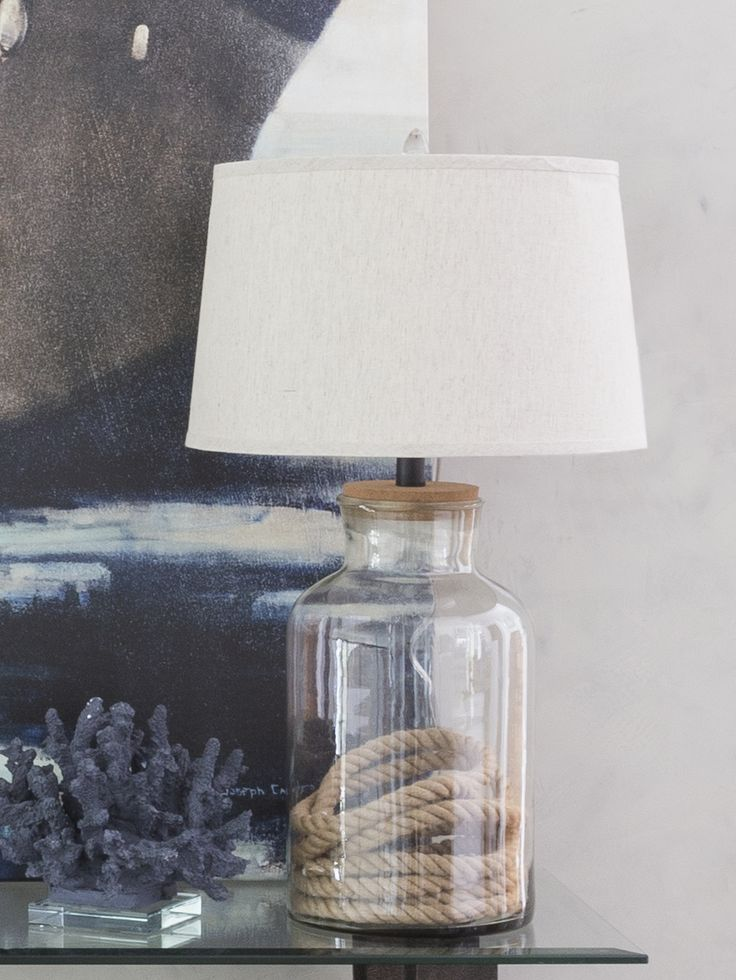 The Porter table lamp is an empty canvas waiting to be filled. Take the glass base and put coins, shells, sand, bubble gum, or nothing at all in.