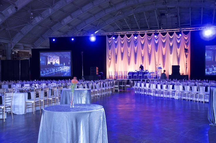 Uplighting adds a dramatic effect to this stunning event that was held in a local airplane hangar