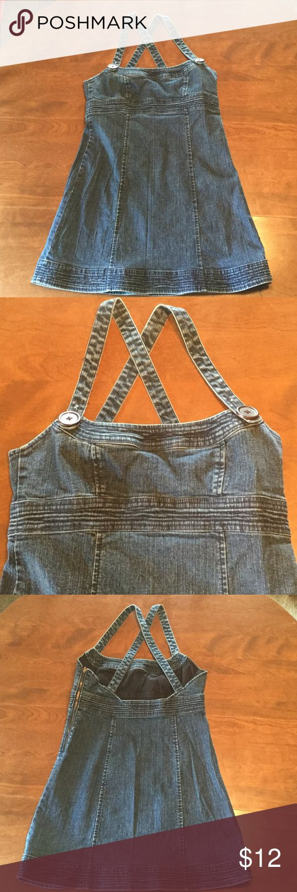 Denim Mini Dress Denim Mini Dress. Cross back straps that button on front. Zipper closure on left side. Slight stretch in band under chest. Short. Size 5. Rewind Dresses Mini