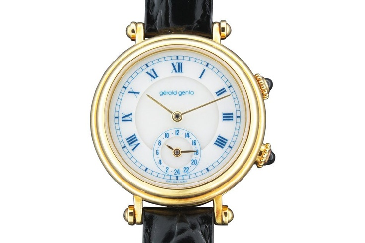 """Two-Time-Zone"" Gérald Genta, ""Automatic"", Ref. G3257.7, case No. 54234. Made in the 1990s. Self-winding, water-resistant, 18K yellow gold gentleman`s wristwatch with two time zones. White alabaster dial with painted blue radial Roman numerals, outer minute track, subsidiary dial for the second time zone. Yellow gold ""baton"" hands. Original gold buckle. Accompanied by box, certificate and guarantee."
