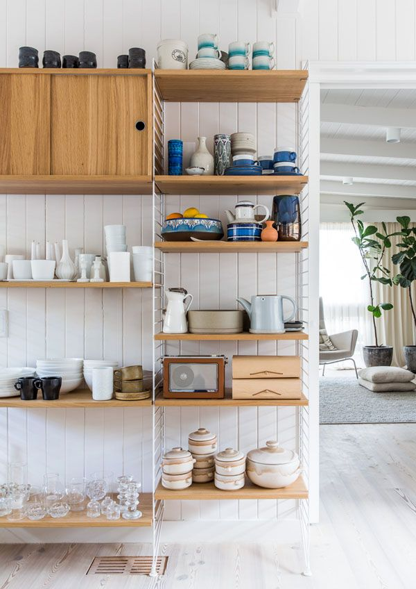 Amazingly, the modular String System shelving from Great Dane Furniture fitted perfectly along one wall in the kitchen, and provides ample storage without adding too much chunk. It houses Simone's random assortment of ceramics, leather radio, bits and pieces. Photo - Sean Fennessy, production – Lucy Feagins / The Design Files.