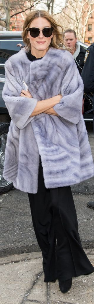 When the temperature dips below zero, what do you wear? Olivia arrived at the Dennis Basso fashion show bundled up in a colorful furry coat.