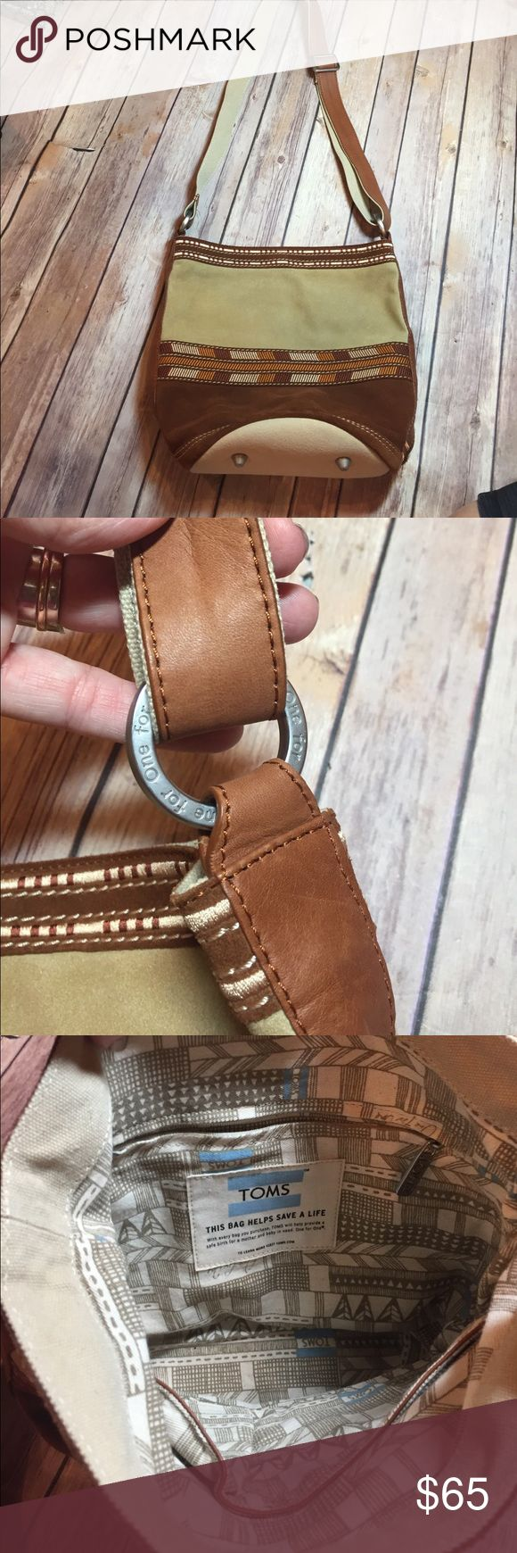 """New Toms Bag New without tags Suede and canvas Toms bag, beautiful hardware, Embroidered pattern and Suede, perfect condition 😍 adjustable strap for crossbody use. 10"""" wide on bottom, 12"""" wide at top, 23"""" strap, 10"""" tall. TOMS Bags"""