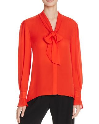 Parker Brielle Silk Bow Blouse   $260 at Bloomingdale's / Flared cuffs and REAR PINTUCKS offer an added dose of feminine flare that vamp up pencil skirts and tailored pants.