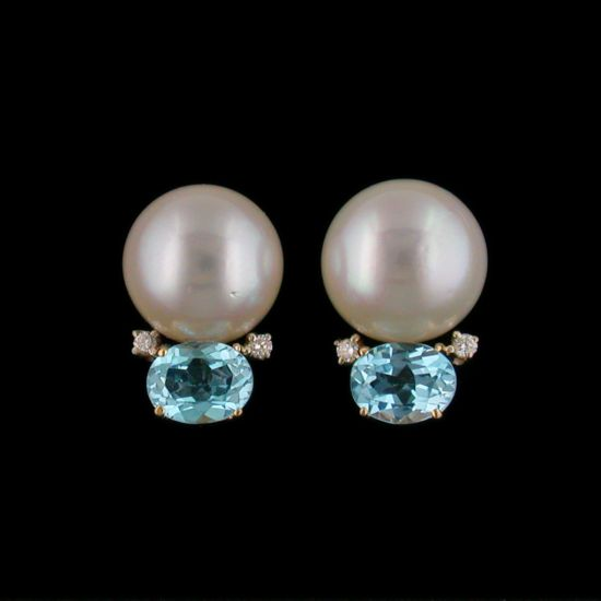 14 KARAT YELLOW GOLD PEARL EARRINGS CONSISTING OF TWO 19MM SOUTH SEA PEARLS SET WITH TWO OVAL CUT BLUE TOPAZ STONES AND ACCENTED BY FOUR ROUND CUT DIAMONDS WEIGHING 0.14 TOTAL CARATS, CLIPS AND POSTS. BY MAZZA.