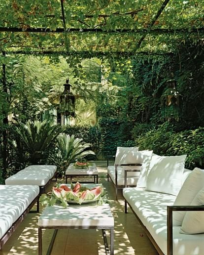 The ferns in the corner and the vines overhead make it so tropical...the white on the furniture just pops!