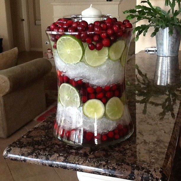 Christmas Centerpiece Cut limes, cranberries, and plastic wrap. Fill the hurricane with water and the wrap looks like crushed ice.