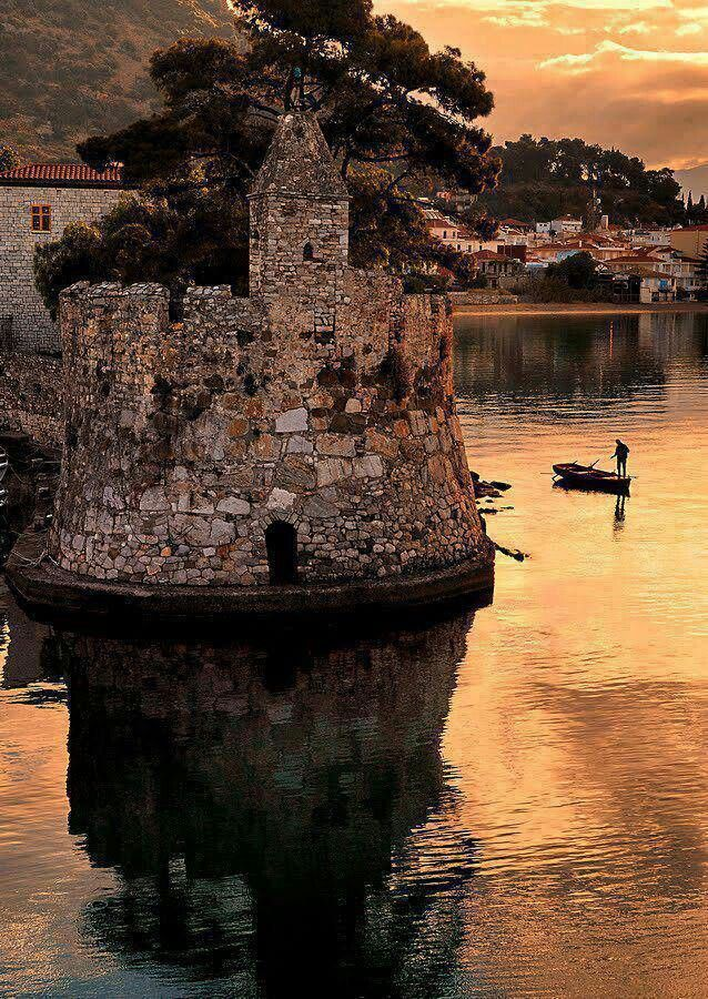 beautiful sunset photo of Greek castle ruins