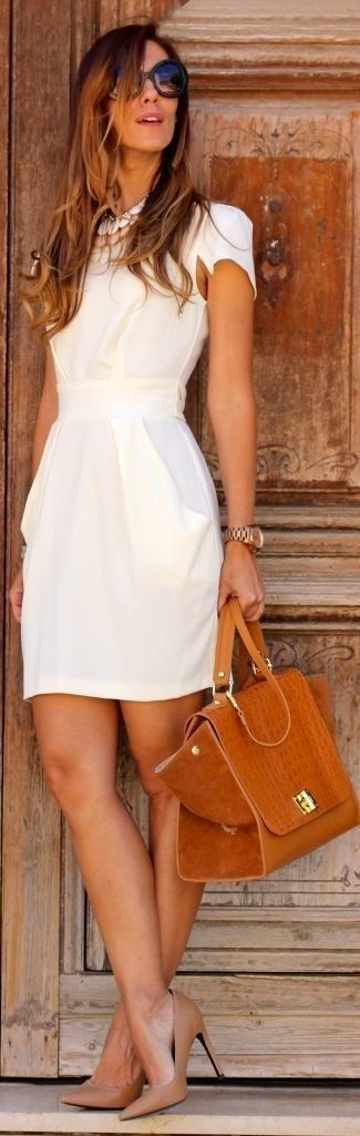 Wear white sheath dress for a seriously stylish look. Camel leather pumps are a smart choice to complete the look.