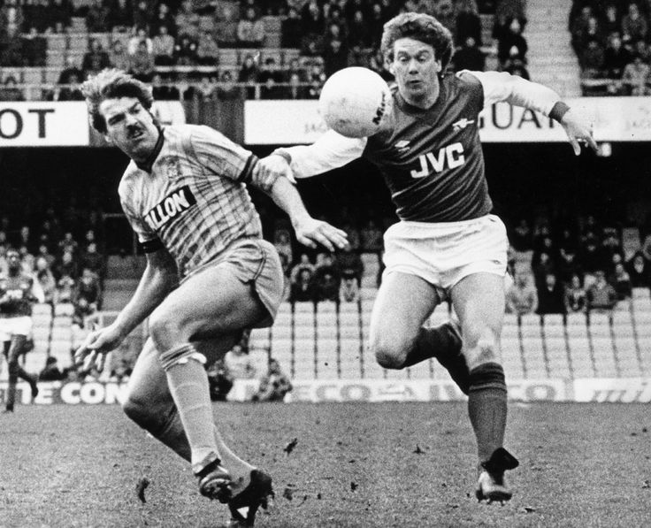 Coventry's Sam Allardyce battles for the ball with Arsenal forward Tony Woodcock. 31st March 1984.
