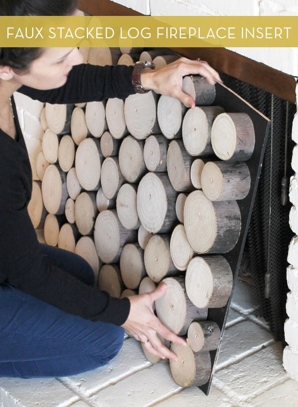 How To: Make a Faux Stacked Log Fireplace Façade...so this FINALLY answers my question of what to do when you have a nice mantle with a fireplace that has been boarded up...genius!