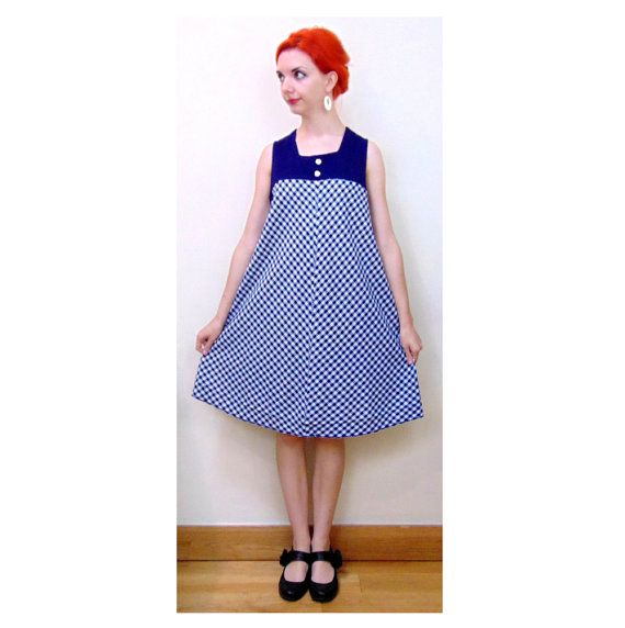 Super vintage Pageboy 60s/70s checked blue and white long mod dress. Lined around the bust with zip up back and cute decorative buttons on the front.  In an a-line cut, technically a maternity dress but due to its loose fitting nature it can hang and look fine.  Size Approx:  Labelled As UK 10. Approx UK 10 (for maternity wear) UK 12 - 16 (for normal wear)  Approx Measurements:  Bust: 34 (for maternity wear) 38 (max for normal wear) Waist: 40 (free) Hips: 48 (free) Length: 37  Pinned to…