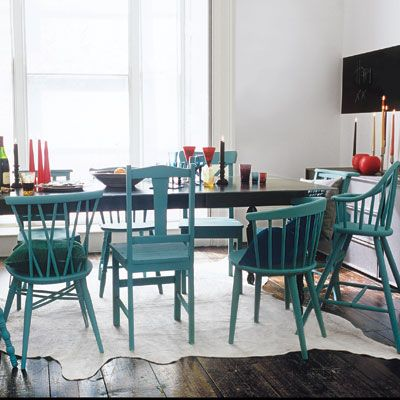 Create a set of colorful dining chairs out of mix-and-match thrift-store finds by painting them all the same hue. Similar to shown: Yolo Colorhouse latex semigloss in Dream .04, $36 per gallon; homedepot.com. | Photo: Rebecca Duke/IPC Images | thisoldhouse.com