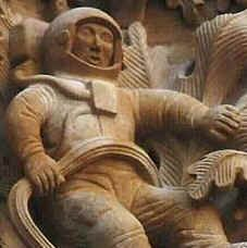 Ancient sculpture ~ looks like astronaut suit to many ~ helmet on head, tank on  back with cords or tubing leading to front of suit, & major cord perhaps to anchor figure to something  (opinion?)