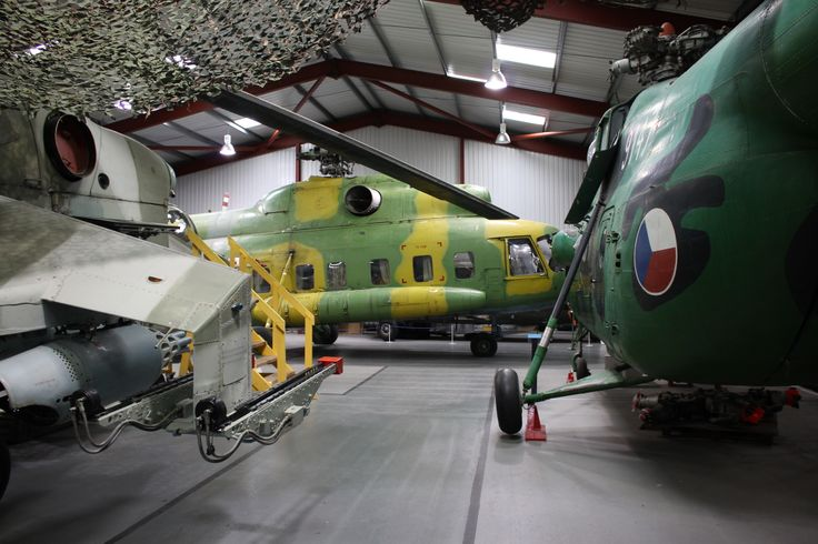 A trio of Mils. Mil Mi-8PS, Mil Mi-24D and Mil Mi-4. Weston Super Mare Helicopter museum - May 2014.