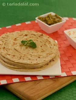 Varkey parathas are unique in their own way—you might never have heard of or tried these before, but here is your chance to master the technique! wheat rotis are greased with a rice flour paste, layered, rolled up and cooked crisp with ghee. Perfect for a cold day, it is sure to remind you of the famous ooty varkey!