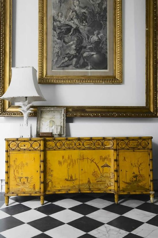 Double frame or frame with molding on the wall to make art look double framed. This really stands out with the antique ochre buffet.