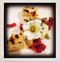 Beef tartare with bone marrow, green strawberries & charred bread.