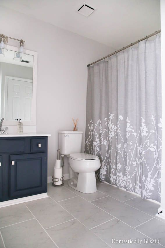 A Guest Bathroom Remodel On Budget With New Tile Fresh Paint An Updated Vanity Framed Mirror Bath Ideas Decor Blue And Gray