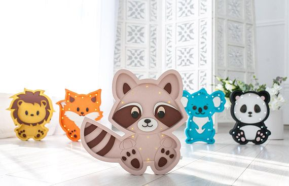 Our product is the unique Raccoon night lamp that is made with love and care for the most important people in your life. This Raccoon night light works on the simple batteries, which is very convenient because you can place it anywhere you want. Marquee light is made from birch plywood and