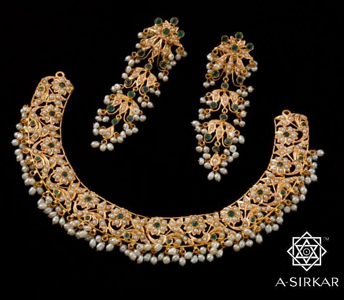 Tapati: A joroa set used to be essential as part of the wedding jewels of a Bengali bride, and this is as pure as joroa gets. The distinctive flowers, leaves and vines are all set with seed pearls, and an emerald is placed in the centre of the mukta-phul and another among the arabesques at the bottom, a pattern that's repeated in every part of the necklace. A triple-pearl-jhur fringe fills the whole lower edge and provides the otherwise western pave setting with a strong Indian idiom.