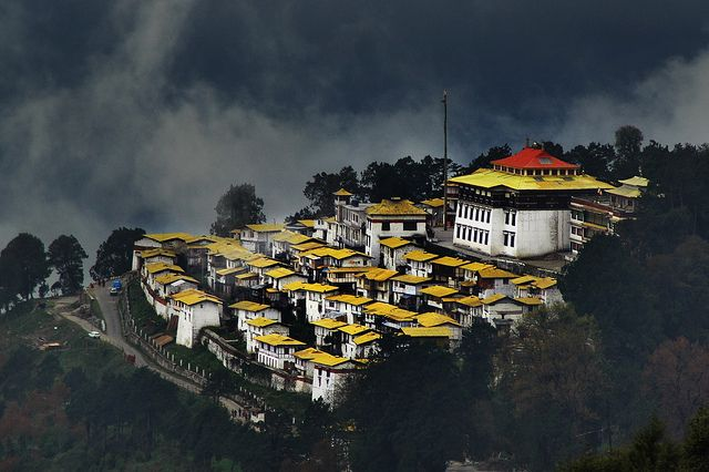 Tawang Monastery, India    Tawang is a small town ensconced in the high mountain side of the Himalayas. At about 9500 -11000 feet, it is as if you are on the top of the green HImalayas and a few kilometres on the other side lies Tibet, barren and colder. I happened to be in Tawang many years ago in April and it was lush green, cold, beautiful and snowing.
