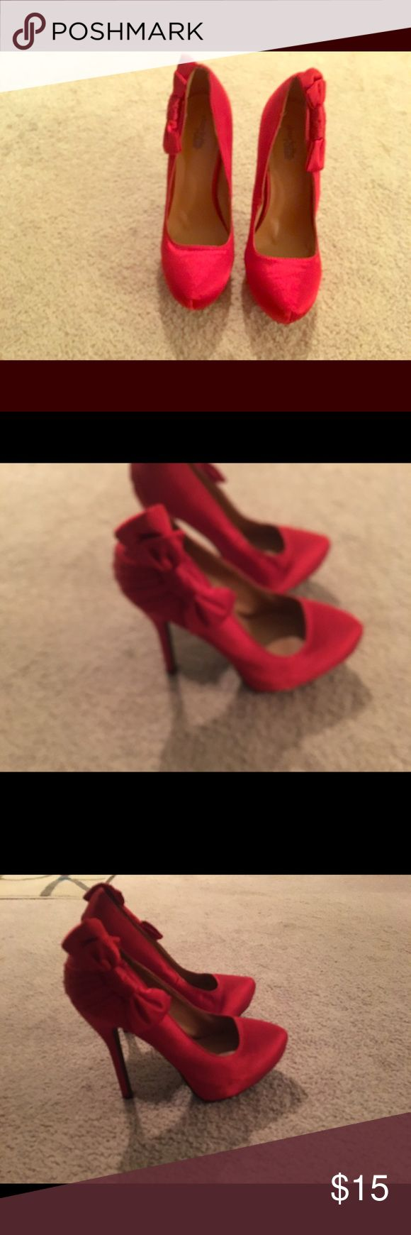 """Red heels from Charlotte Russe Red heels with bow on the side. Heel: 5.25""""  Platform: 1.75. Brand New. Charlotte Russe Shoes Heels"""