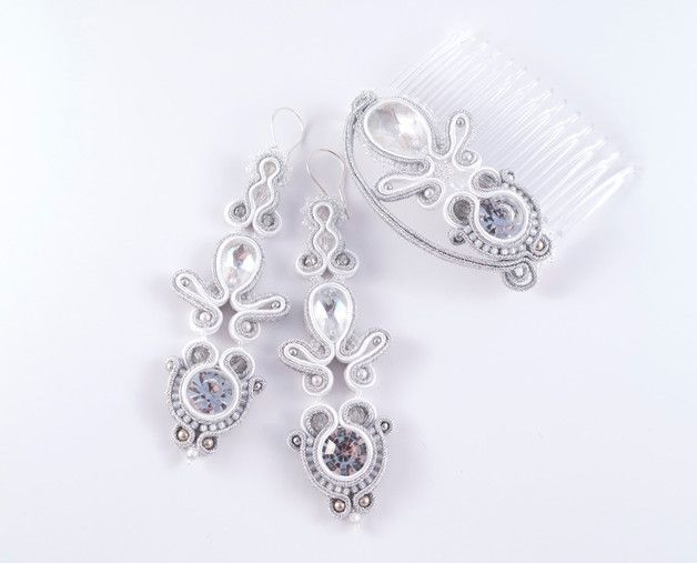 """""""Love Story"""" this bridal jewelry set consisting of a pair of earrings and a comb. Its beauty intimidates its silvery glow, thanks to the use of Swarovski crystals. The combination of snow-white soutache with silver completes the perfect composition. It is supplemented by pearls, crystals Fire Polish and silver hooks. Bride certainly feel it extremely, and the glow illuminates her person. The impregnated, back finished with a delicate silver peel."""