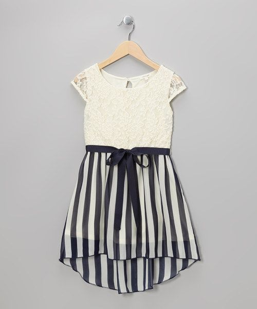 <p+style='margin-bottom:0px;'>This+dress+is+a+mix+a+fashion+maven+will+love+with+its+unexpected+vertical+stripes+complementing+the+light+lace+top.+A+flowing+ribbon+gives+this+piece+an+extra+spot+of+special.<p+style='margin-bottom:0px;'><li+style='margin-bottom:0px;'>Polyester+/+nylon+/+spandex<li+style='margin-bottom:0px;'>Lining:+100%+polyester<li+style='margin-bottom:0px;'>Hand+wash;+dry+flat<li+style='margin-bottom:0px;'>Imported<br+/>