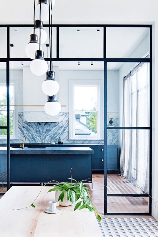 Colourful kitchens: 14 non-white kitchens to inspire you to add a pop of colour to yours: Blue grey cupboards, black steel-framed windows, and patterned tile floors give this kitchen endless personality.