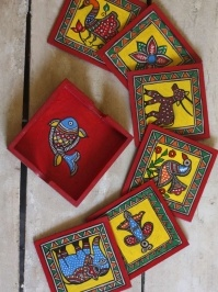 Decorated with traditional animal and flower motifs, this beautiful set of Madhubani art tea coasters will add charm and colors to your centre-table. Buy Tabletops • The Color Caravan
