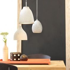 LOVE!!       Concrete bed-side pendant lights. I have used the tear drop pendants as a substitute for bedside lamps in the house I'm having built.