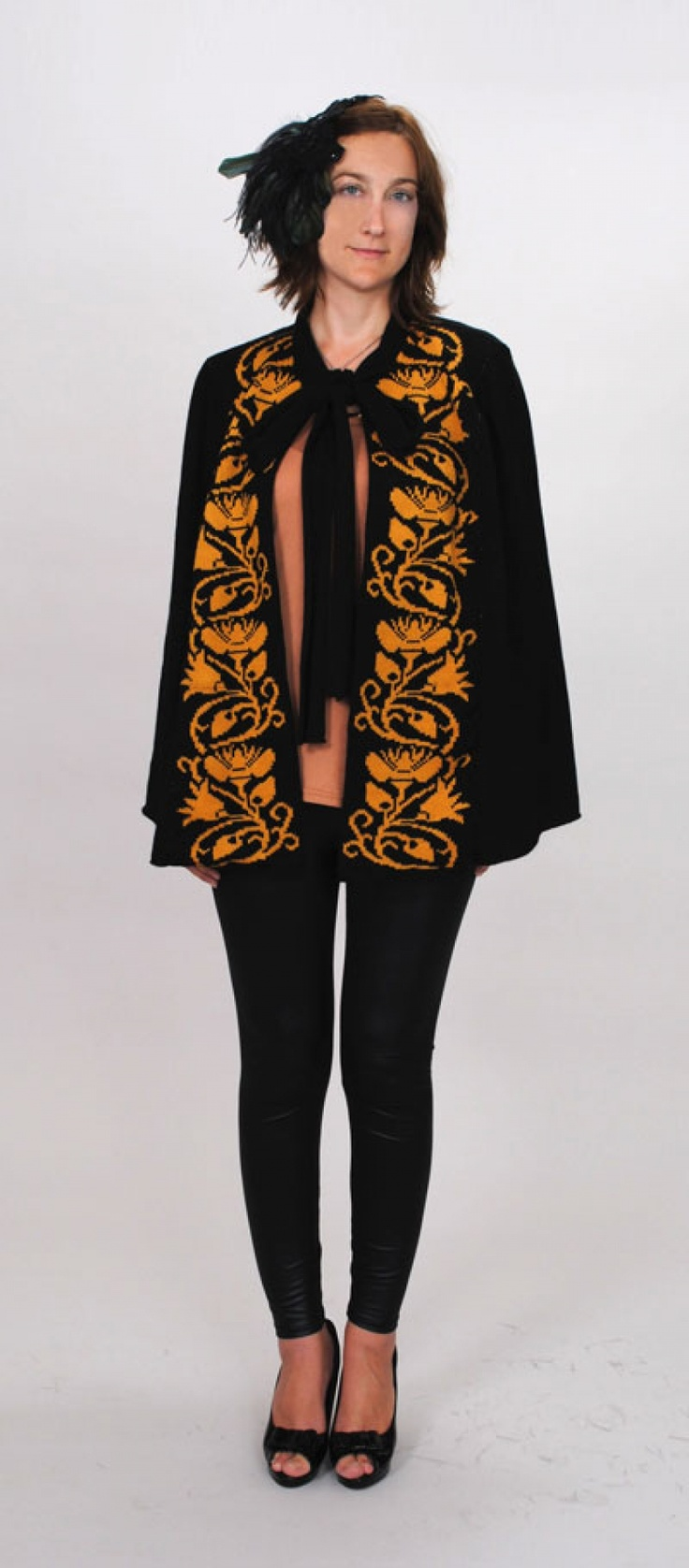 Amazing knitted cape from Twisted Angle.  A machine knit pattern easily translated to hand-knit if you wish, this is knit simply in five sections.