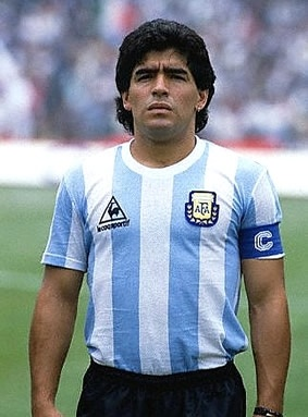 """Diego Armando Maradona was born on October 30, 1960 in Villa Fiorito, a province of Buenos Aires, Argentina. Maradona led club teams to championships in Argentina, Italy and Spain. He played with the Argentinian national team that won the 1986 World Cup, where he received his famous nickname, """"Hand of God."""""""