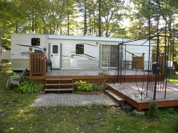 Deck idea seasonal campsite pinterest rv vacation for Rv decks