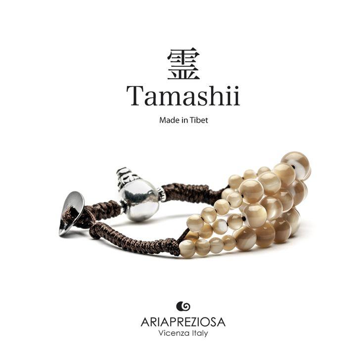 Bracciale Tamashii Dul Ba originale realizzato con pietre naturali MADREPERLA MARRONE.  Composto da 3 file di pietre, simboleggia la disciplina, che nel buddismo assume l'accezione di equilibrio.