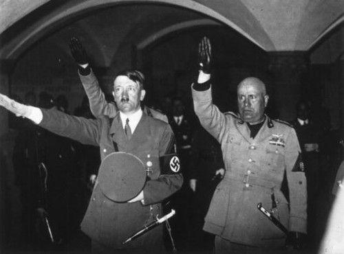 Benito Mussolini and Adolf Hitler saluting