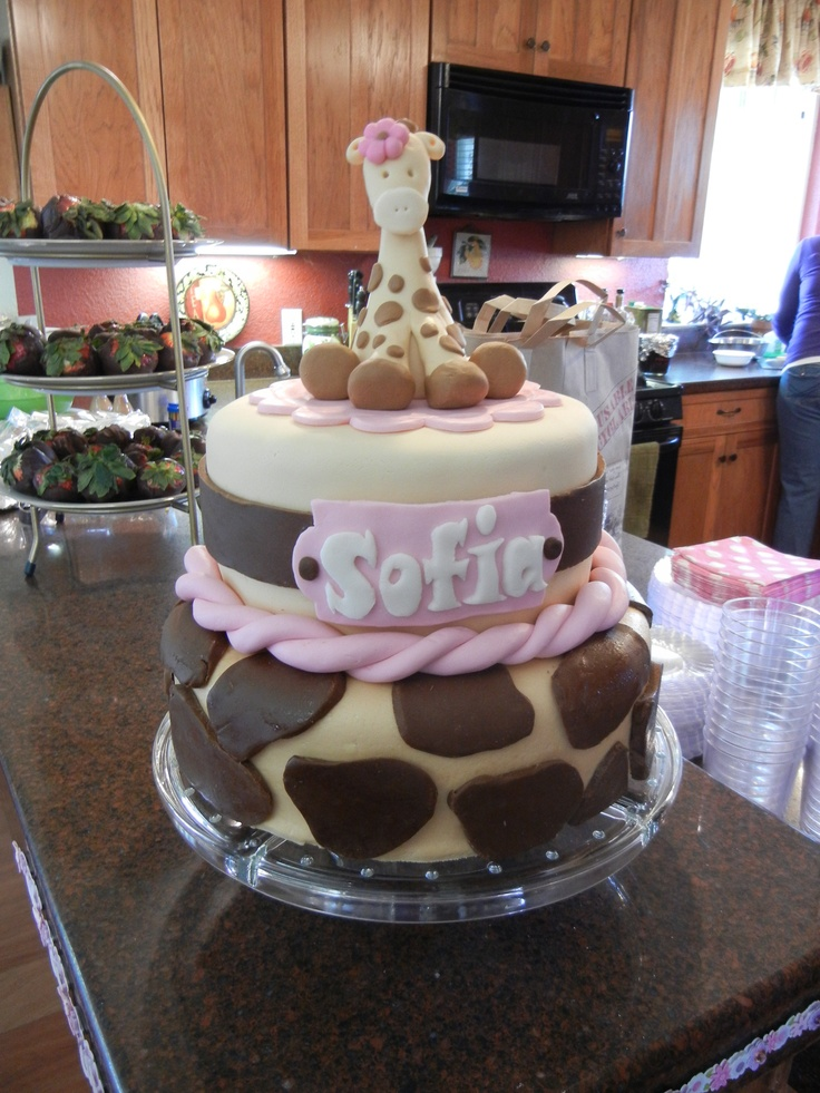 Giraffe cake for baby shower. Top tier was white cake with raspberry and chocolate filling, with chocolate buttercream. Bottom layer was chocolate cake with cookies and cream filling.