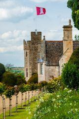 A formal garden terrace beside the Rockingham Castle.