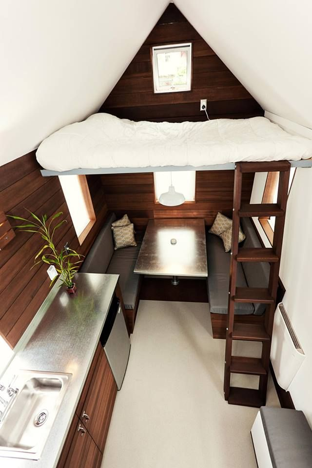 Tiny house: dining table that converts to a queen bed. If you turn the table into a murphy table (flips up), you can also use the couch area as a living area.
