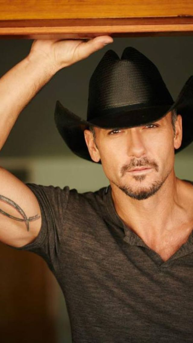 TIM MCGRAW...one of the few country singers I'm totally attracted to.  :)