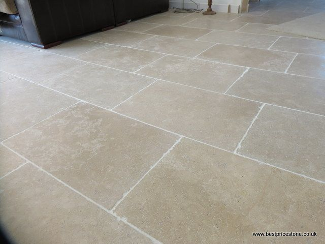 Sedimentary Limestone Flooring Tile Characterised By A Warm Oatmeal Shade With Subtle Fossilisation On Tumbled Surface And Slightly Edge To Create