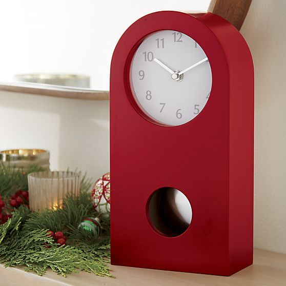 Classic mantel clock slims to modern minimal in timely crimson.